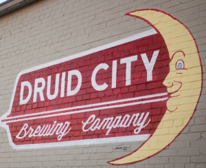 Druid City Brewing Company sign painted on the side of the building.