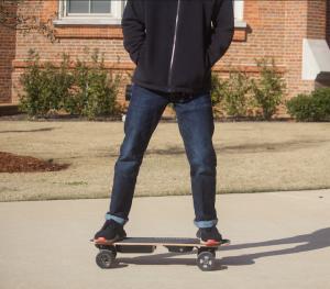 UA Student riding skateboard
