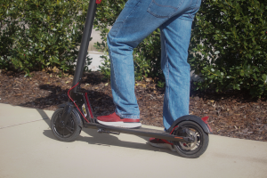 UA student on electric scooter